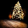 Leinwanddruck Bild - Dark wooden old table and chrismtas tree