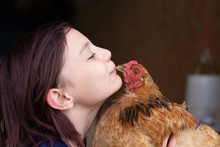 Girl Getting Kissed By A Chicken