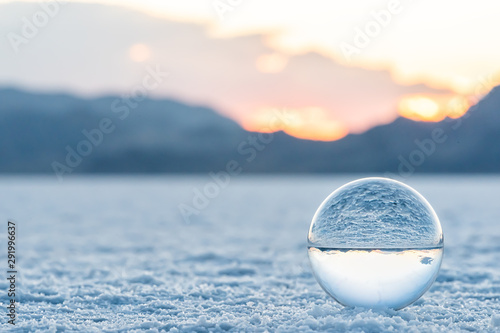 Fototapeta Bonneville Salt Flats low angle ground level landscape view near Salt Lake City, Utah and sand texture with crystal ball reflection obraz