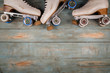 Leinwanddruck Bild - artistic roller skates on a wood background