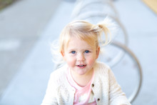 Portrait Of Toddler Girld With Blonde Hair And Blue Eyes