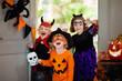 canvas print picture Kids trick or treat. Halloween. Child at door.