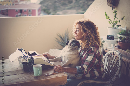 Fototapeta cute couple of best friends together - woman with pug sitting on her legs, old j