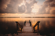 A Dock At Sunset In The Florida Keys Is The Perfect Spot For Relaxing