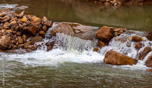 Foto auf Gartenposter Forest river water flowing over rocks