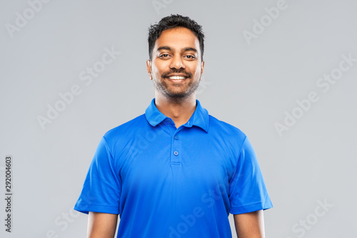 emotion, expression and people concept - smiling indian man in blue polo shirt o Canvas-taulu
