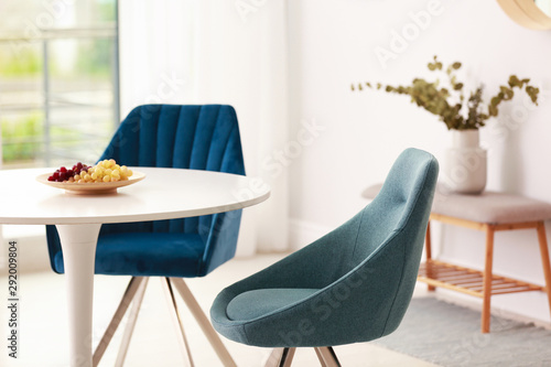 Obraz na plátně  Modern dining room interior with table and chairs