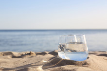 Sandy Beach With Glasses Of Re...