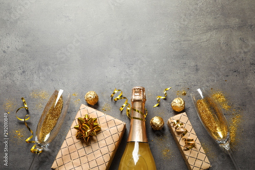 Poster de jardin Bar Flat lay composition with bottle of champagne for celebration on grey stone background. Space for text
