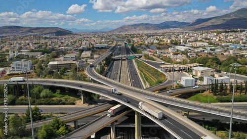 Cuadros en Lienzo Aerial photo of multilevel junction highway overpass in urban area with beautifu