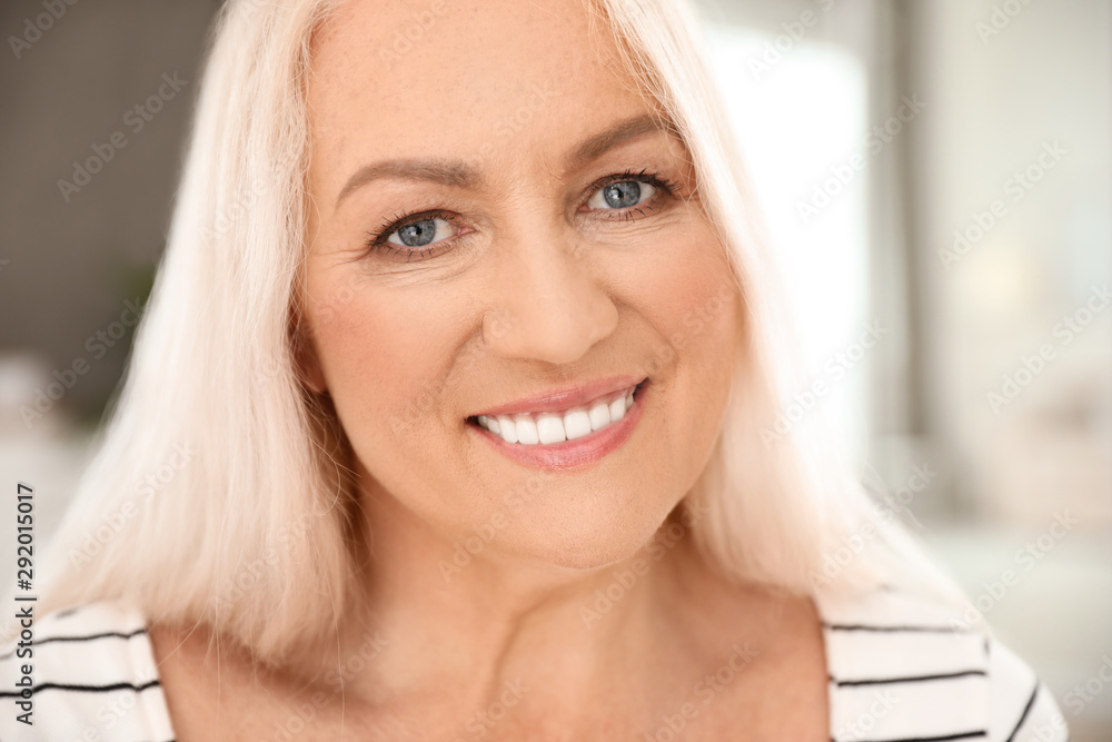 Fototapety, obrazy: Portrait of mature woman with beautiful face on blurred background, closeup view