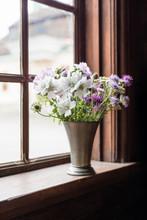 Summer Flowers In An Old Window