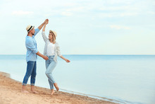 Happy Romantic Couple Dancing On Beach, Space For Text