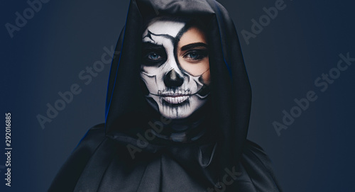Fotomural Young female in hooded cape with scary makeup