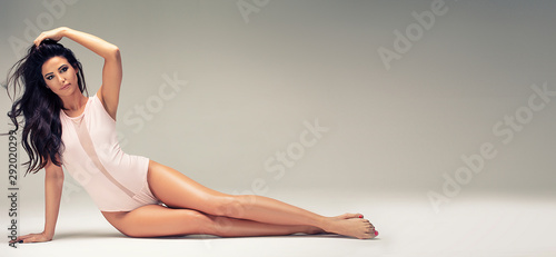Slim beautiful girl posing in studio. Fototapet