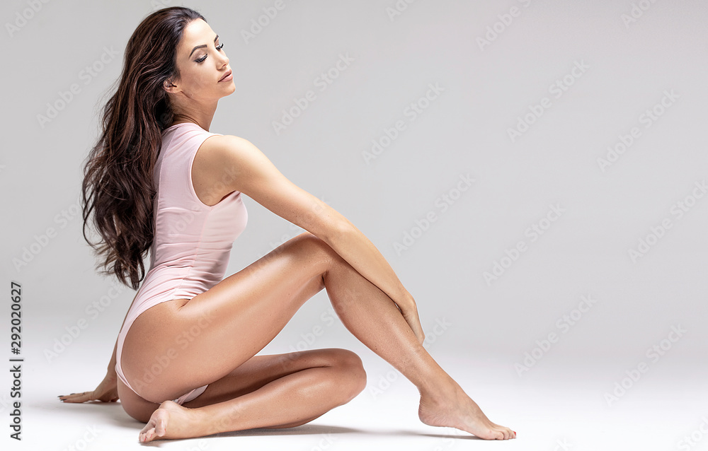 Slim beautiful girl posing in studio.