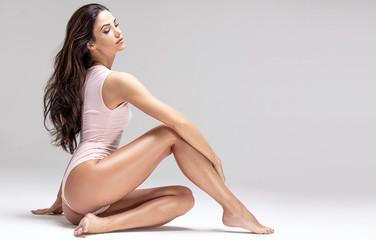 Slim beautiful girl posing in studio.