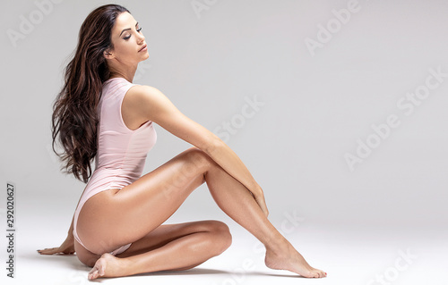 Slim beautiful girl posing in studio. - fototapety na wymiar
