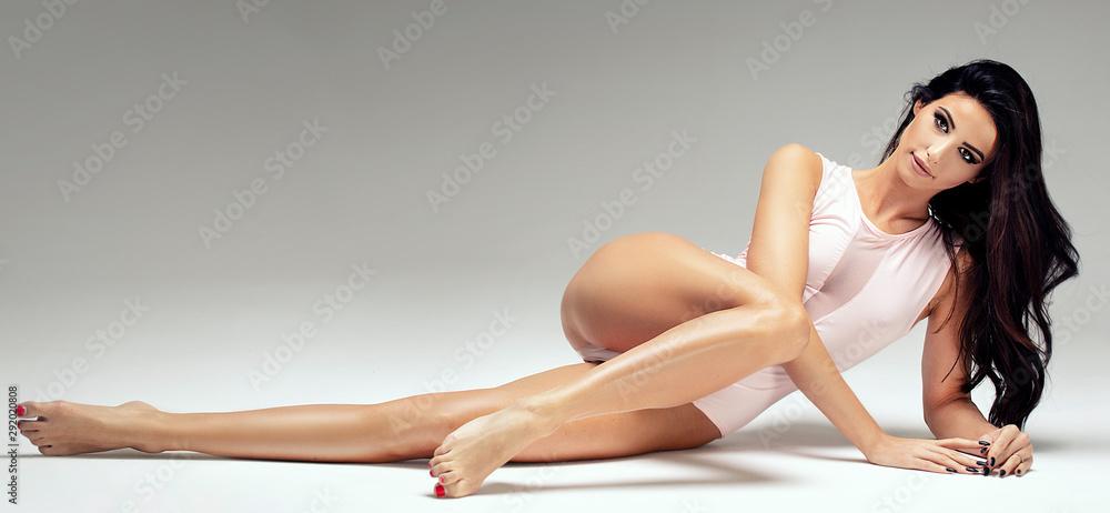 Fototapeta Slim beautiful girl posing in studio.