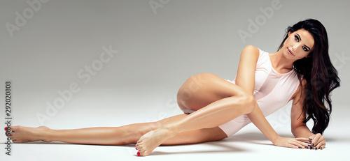 Slim beautiful girl posing in studio. Canvas Print
