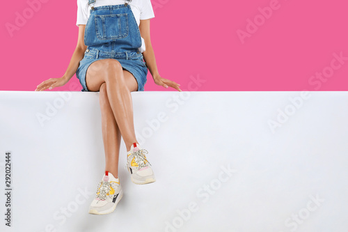 Woman wearing stylish shoes on color background, closeup - 292022444