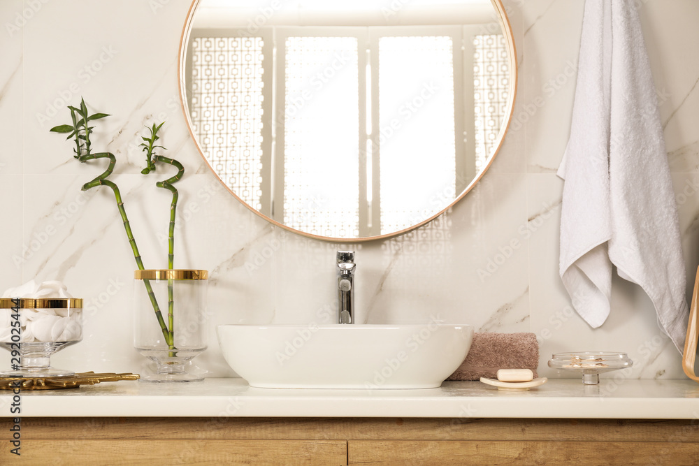 Fototapeta Stylish bathroom interior with vessel sink and round mirror