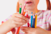 Humorous Photo Of Great Artist. Portrait Of Cute Little Child Girl With Colored Pencils.