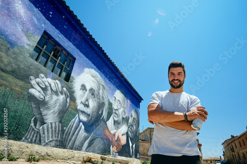 Photo  Man Painting Graffiti Along The Camino de Santiago
