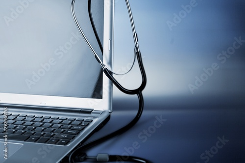 Papel de parede  Laptop diagnosis with  stethoscope  on background