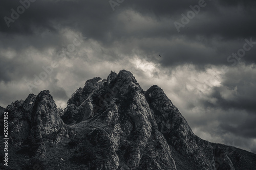 Mysterious black mountain with dramatic cloudy sky - 292037852