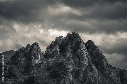 Foto op Canvas Bleke violet Mysterious black mountain with dramatic cloudy sky