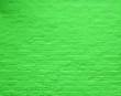 Leinwanddruck Bild - an old rough brick wall painted a vivid bright green color