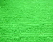 An Old Rough Brick Wall Painted A Vivid Bright Green Color