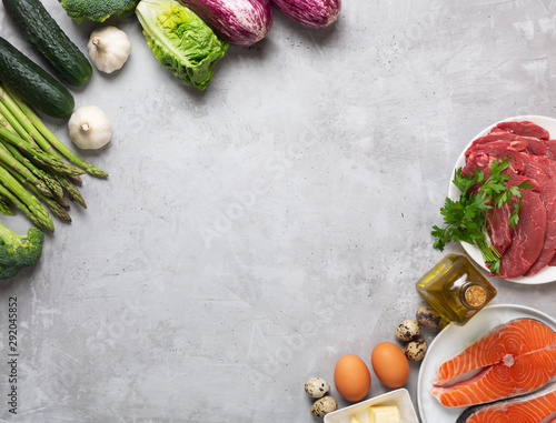 Photo Atkins Diet food ingredients on concrete background, health concept, top view wi