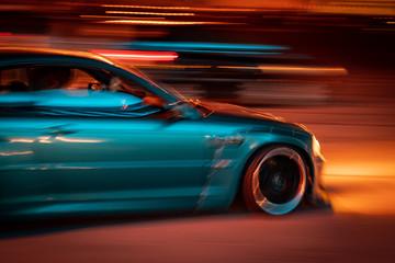 marina blue car racing at night