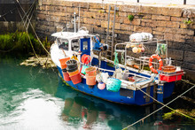 Small Fishing Boat Full Of Col...