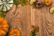 Leinwandbild Motiv Autumn decoration with fallen leaves and pumpkin on wooden background