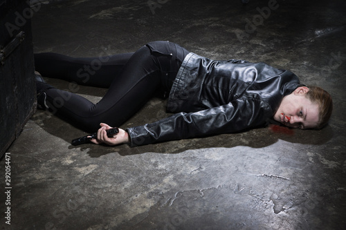Photo  Crime scene imitation. Dead woman lying on a floor..