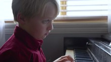 Bored Child Upset He Has To Practice Playing The Piano.