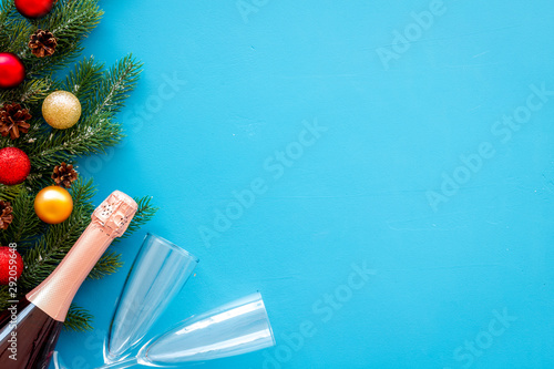 Champagne as New Year symbol on blue background top view frame copy space Wallpaper Mural