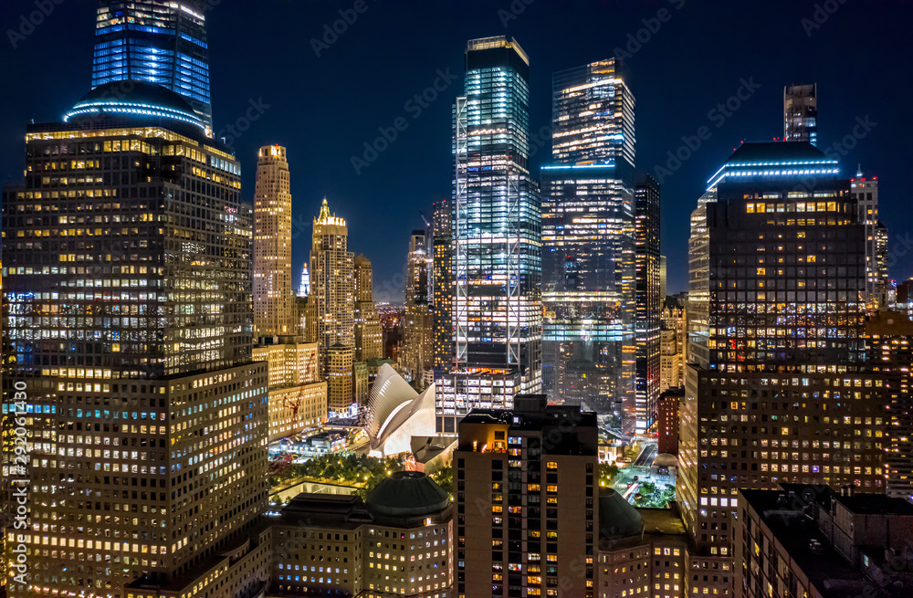 Fototapety, obrazy: Aerial drone view of New York skyscrapers at night in Lower Manhattan