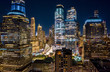 canvas print picture Aerial drone view of New York skyscrapers at night in Lower Manhattan