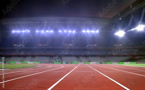 Fototapeta Running track in a stadium under bright spotlights obraz