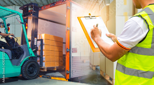 Pinturas sobre lienzo  double exposure of forklift loading cargo into the container, worker hand holding clipboard inspecting checklist delivery load shipment, freight industry warehouse logistics transport