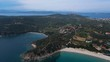 Circling drone shot of Ouranoupoli forest and beach
