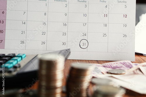 Cuadros en Lienzo debt collection and tax season concept with deadline calendar,coins,calculator o