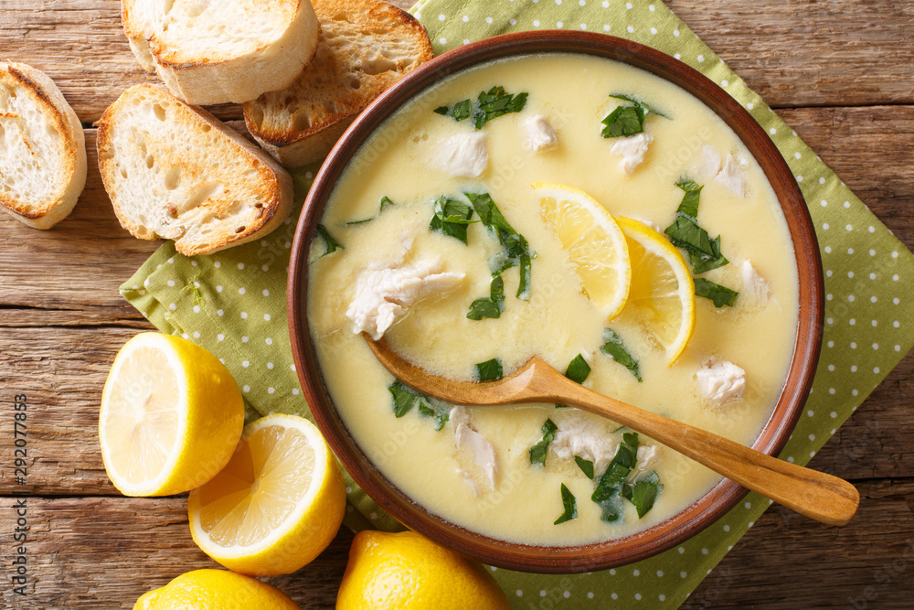 Fototapety, obrazy: Thick aromatic Greek lemon soup with chicken and orzo paste close-up in a bowl. Horizontal top view