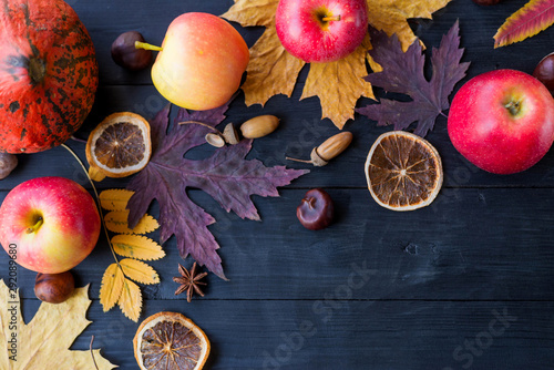 Valokuva  Autumn composition with copy space: yellow leaves, apples, pumpkin on a wooden table