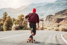 Man Skateboarding At Mountain ...
