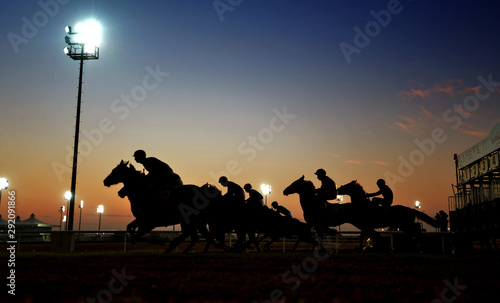 Fotomural  horse riders in silhouette to ahead the championship.